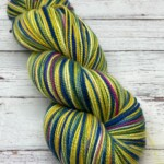 A twisted skein of yellow, blue and pink sock yarn.